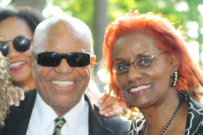 Berry Gordy poses with Cal Street, lead singer of the Motown group, the Velvelettes.