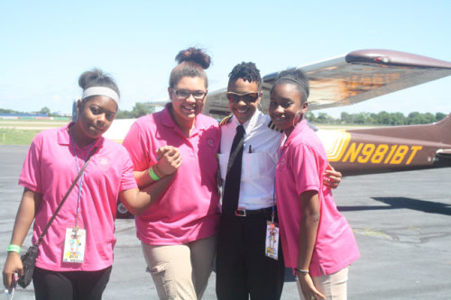 Pilot Monique Grayson greets girls after their first airplane rides.