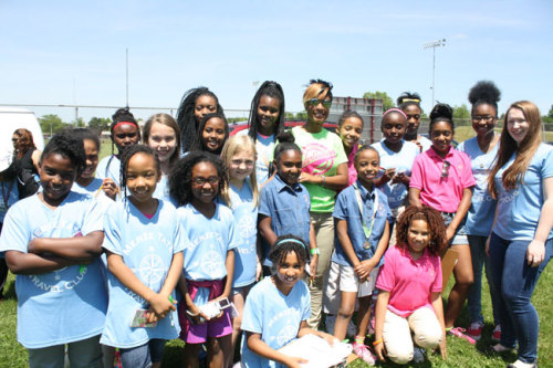 Students of the Merze Tate Travel Club go on assignment to the annual Greg Jennings Football and Cheer Camp where they interviewed students and the camp's founders.