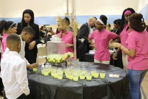 Girls and new Explorer boys chapter, prepare drink table for the reception following the MLK event. Photo by Shemaiah Lawler